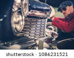 Classic Car Passionate. Caucasian Collector Looking For the New Vintage Car For His Collection. History of American Transportation Concept Photo. - stock photo