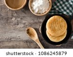 arepas in iron pan on wooden...   Shutterstock . vector #1086245879