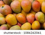 mango fruits in basket at... | Shutterstock . vector #1086262061