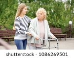 young woman and her elderly... | Shutterstock . vector #1086269501