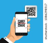 hand holds phone with qr code... | Shutterstock .eps vector #1086298517