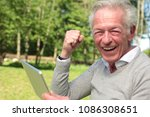 beautiful old happy man outside | Shutterstock . vector #1086308651