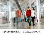 couple shopping. happy man and... | Shutterstock . vector #1086309974