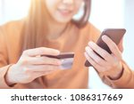 woman hands holding credit card ... | Shutterstock . vector #1086317669