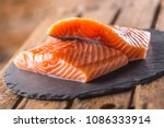 raw salmon fillets on slate and ... | Shutterstock . vector #1086333914