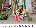 sisters sitting on a step | Shutterstock . vector #1086342419