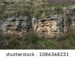 ancient rocks in the faces shape | Shutterstock . vector #1086368231