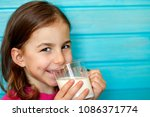 cute little girl enjoys the... | Shutterstock . vector #1086371774
