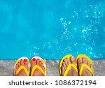 feet in flip flops on stone...   Shutterstock . vector #1086372194