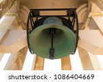 green corroded bell surrounded... | Shutterstock . vector #1086404669