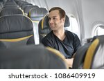 nice man sits in the airplane...   Shutterstock . vector #1086409919