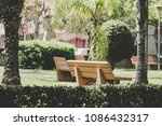 empty benches inside a... | Shutterstock . vector #1086432317