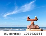 symbolic scales of stones on... | Shutterstock . vector #1086433955