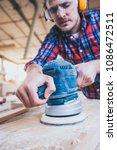 carpenter at work polishing... | Shutterstock . vector #1086472511