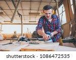 carpenter at work polishing... | Shutterstock . vector #1086472535