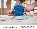 close up of carpenter at work... | Shutterstock . vector #1086472595