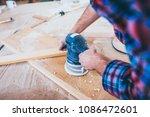 carpenter at work polishing... | Shutterstock . vector #1086472601