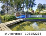 Waterfront Lake With Pier With...