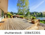 Large Wood Deck Near House Wit...