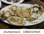 grilled scallops with garlic... | Shutterstock . vector #1086524465