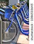 Small photo of Blue Bicycles at Rental Depot Abstract