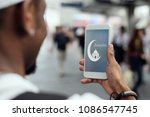 muslim boy using a smartphone | Shutterstock . vector #1086547745