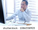 businessman using a desktop... | Shutterstock . vector #1086558905