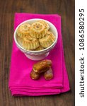 bowl of date cookies with whole ... | Shutterstock . vector #1086580295
