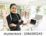 happy asian smart looking... | Shutterstock . vector #1086585245