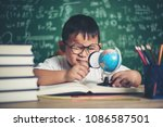 kid observing or studying... | Shutterstock . vector #1086587501