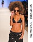 miami   july 23  model walks... | Shutterstock . vector #108660035