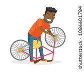 black man working in the bike... | Shutterstock .eps vector #1086601784