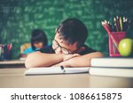 boy sleeping on the books in... | Shutterstock . vector #1086615875