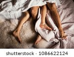 legs of a couple in bed | Shutterstock . vector #1086622124