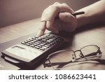 hand of a man calculating the... | Shutterstock . vector #1086623441