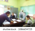 Small photo of State officials are advise the people in room, blurred image