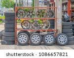 car wheels and tires on display ... | Shutterstock . vector #1086657821