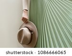 hat  beige blouse and turqoise...   Shutterstock . vector #1086666065