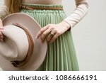 hat  beige blouse and turqoise... | Shutterstock . vector #1086666191