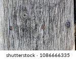 old gray wooden board in cracks.... | Shutterstock . vector #1086666335