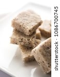 Small photo of Coconut burfi or Nariyal Barfi is a sweet cake served in a plate selective focus