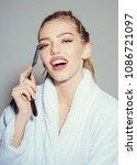 girl on smiling face wears...   Shutterstock . vector #1086721097