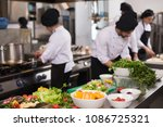 professional team cooks and... | Shutterstock . vector #1086725321