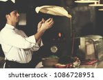 skilled chef preparing dough... | Shutterstock . vector #1086728951