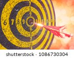 old dartboard with arrow at... | Shutterstock . vector #1086730304