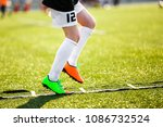boy improving speed with ladder ... | Shutterstock . vector #1086732524