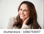Smiling Brunette Woman Looking...