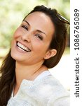 carefree brunette laughing to... | Shutterstock . vector #1086765089
