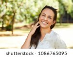 gorgeous woman smiling in park  ... | Shutterstock . vector #1086765095