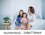 little girls trust a young... | Shutterstock . vector #1086778469